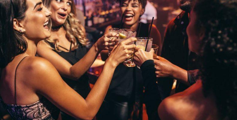 friends having fun at the bar, drinking